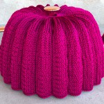 Knitted tea cozy with a Stockinette pattern formed by repeated knit stitches